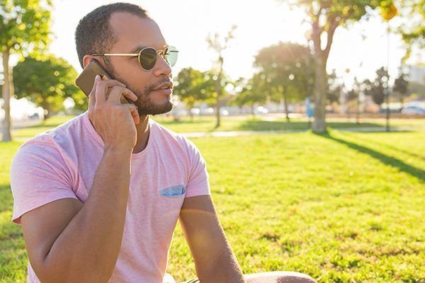 Young man on the phone outside