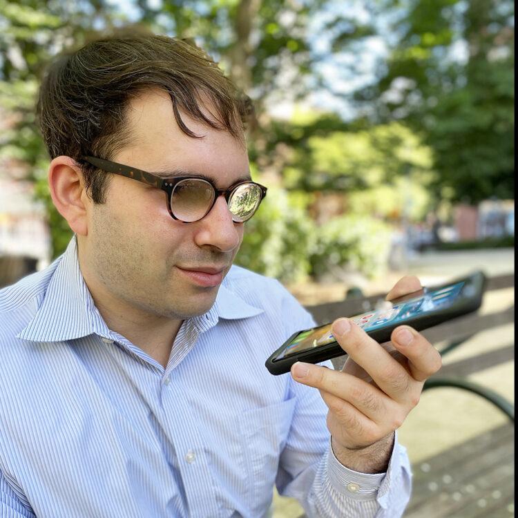 Man using Navilens app to identify entrance - closeup