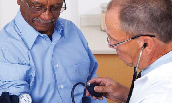 Male patient receiving blood pressure test