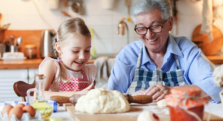 Grandmother and granddaughter cooking together at home