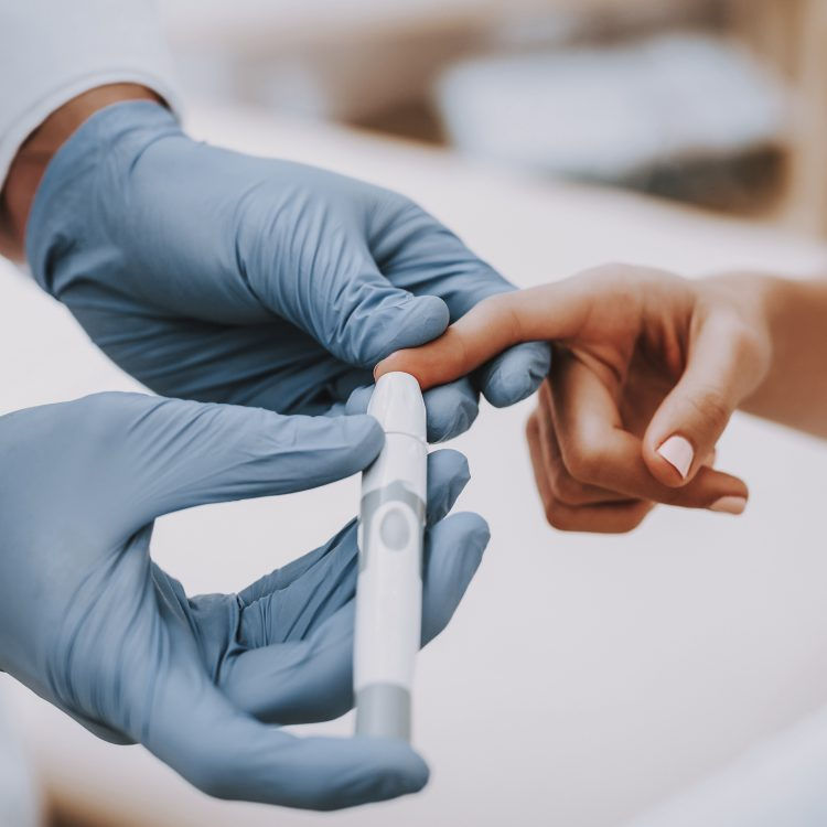 Doctor performing blood test