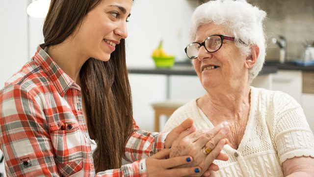 Social worker with an elderly client