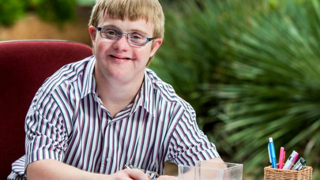 A young teen with low vision.