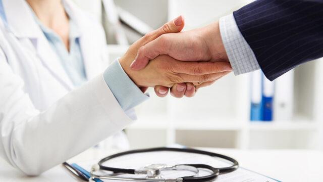 Medical professionals shaking hands.