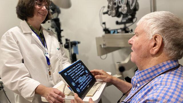 Doctor demonstrating assistive technology.