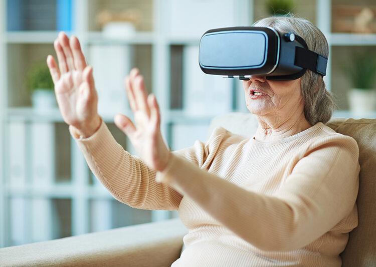 Senior woman gaining experience with virtual reality stimulator
