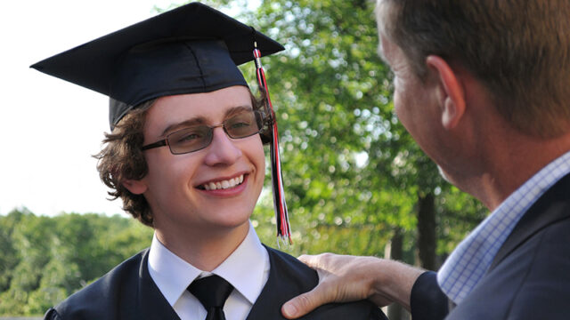 Father congratulating son at Graduation