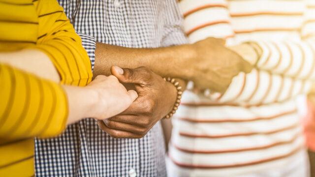Community holding hands.