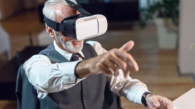 A senior man experiencing virtual reality technology.